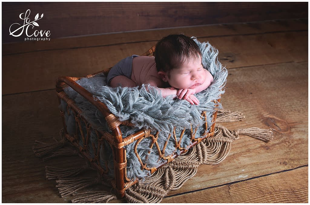 baby posed in a bed