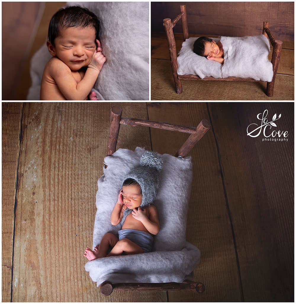 baby sleeping posed in a bed
