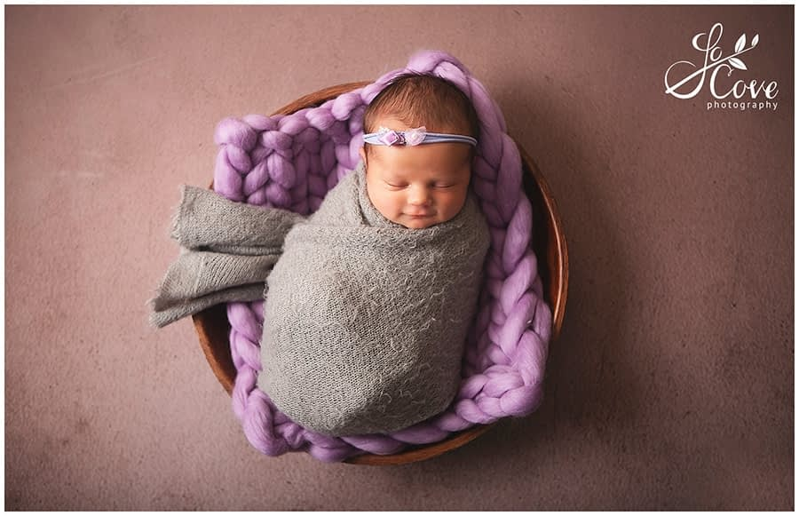baby photographed in a bowl